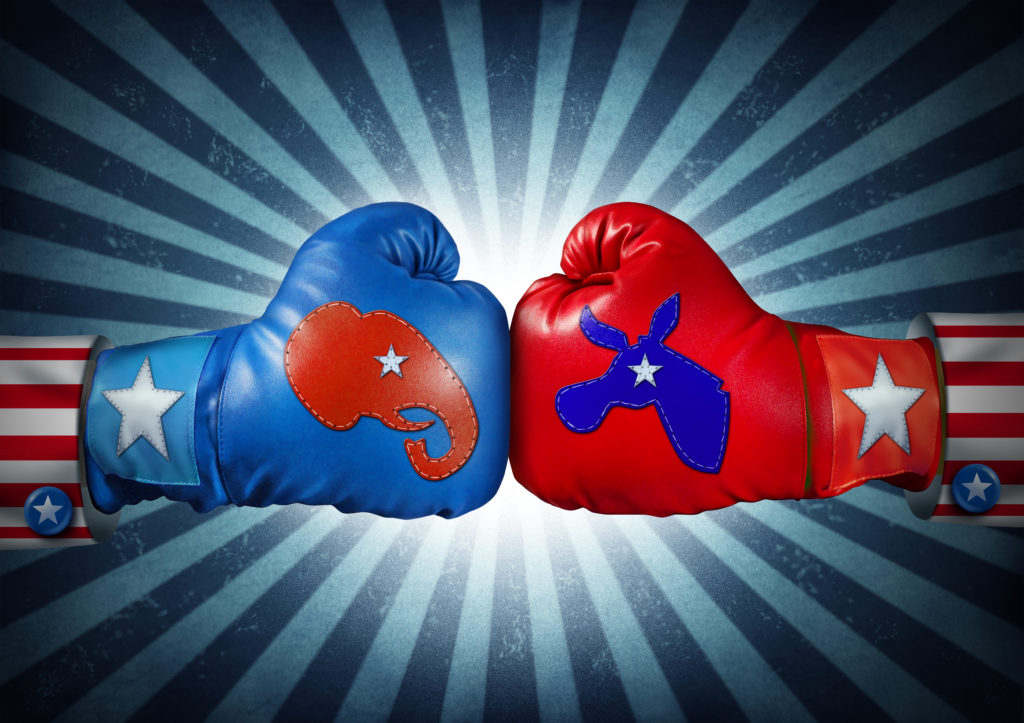 American election campaign fight as Republican versus Democrat as two boxing gloves with the elephant and donkey symbol stitched fighting for the vote of the United states presidential and government seat.