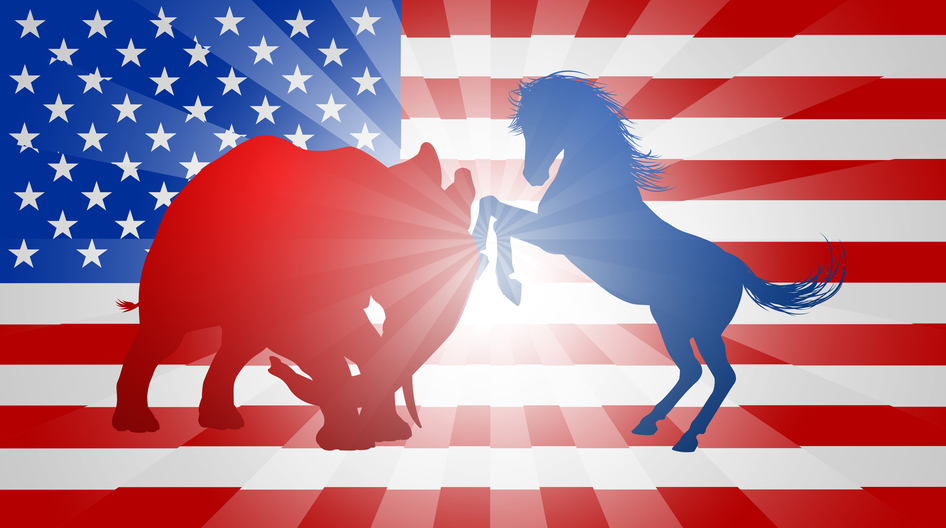 A donkey and elephant fighting in silhouette.  Mascot animals of American democratic and republican parties, concept for the presidential election or politics in general